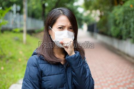 asian woman wear face mask in