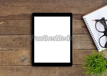 digital tablet on wood table blank