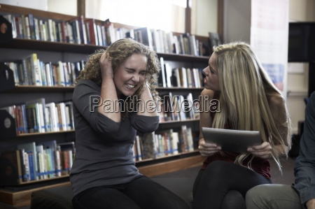 two female students arguing in a
