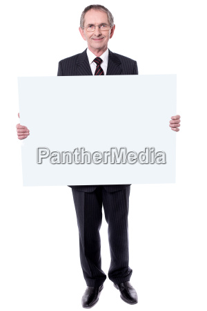 handsome aged man holding blank white