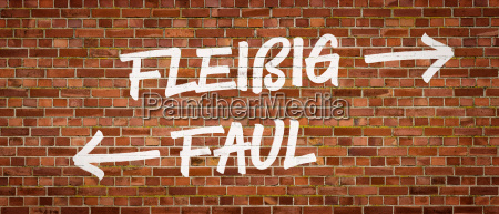 font on brick wall diligent or
