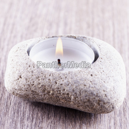 candle in stone