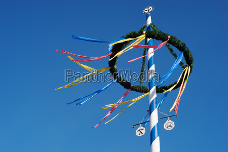 bavarian maypole against blue sky