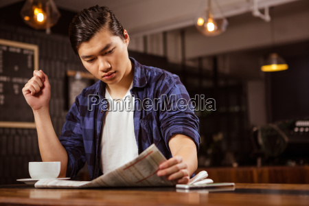 hipster man reading newspaper