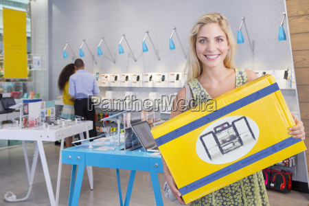 woman with purchase in electrical store