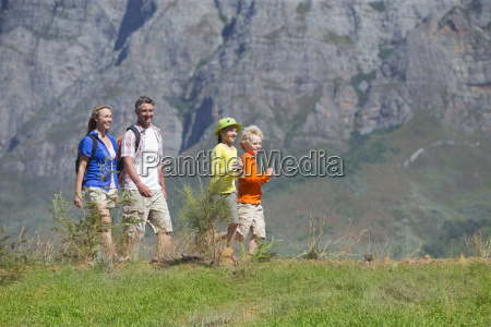 multi generation family hiking on mountain