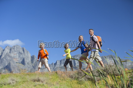 family hiking on a mountain path