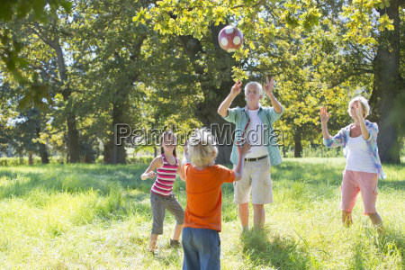 multi generation family playing catch in