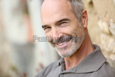portrait of smiling handsome mature man