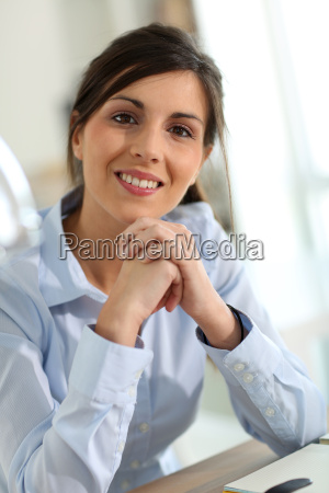 portrait of smiling brunette woman in