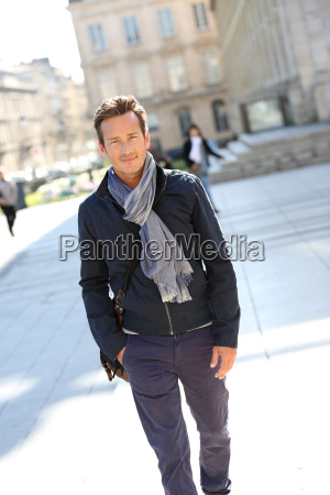 handsome man walking in the street