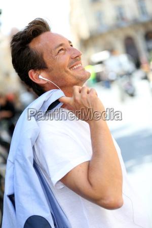 trendy handsome man talking on phone