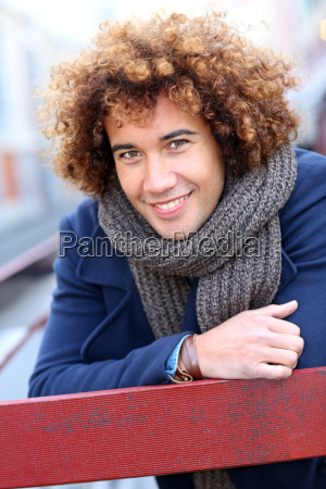 handsome mixed raced guy in city