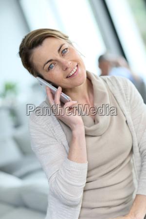 portrait of mature blond woman talking