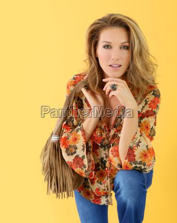 beautiful trendy woman isolated on yellow
