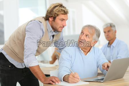 senior man attending business class with