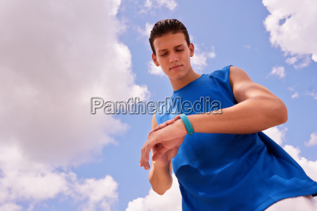 young man sports training fitness fitwatch