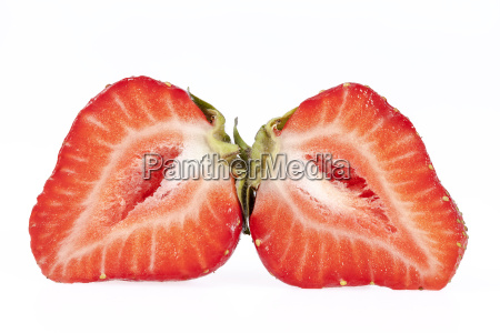 fruits of red cut strawberries isolated