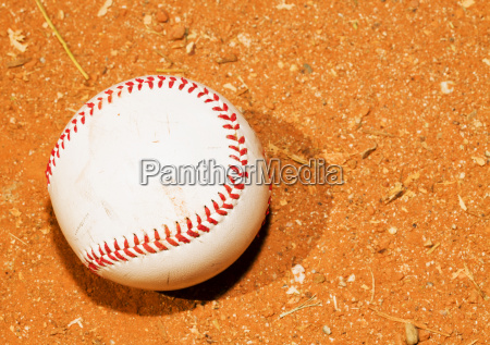 baseball on a red field