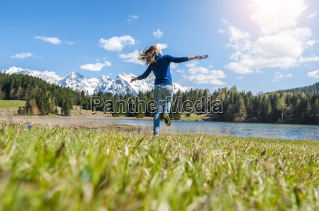 germany bavaria carefree woman at lake