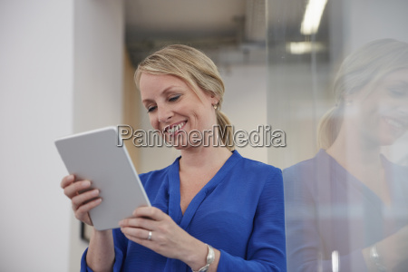 businesswoman in office using digital tablet