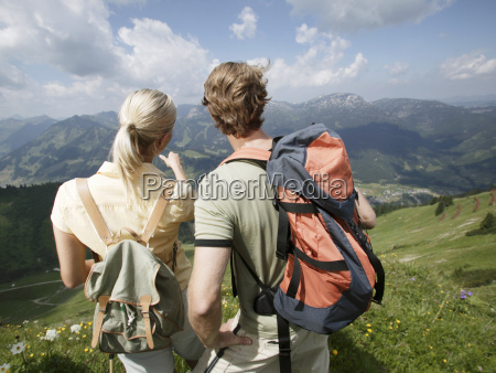 couple looking out over valley kleinwalsertal