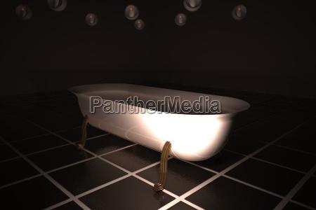 white bathtube in dark bathroom