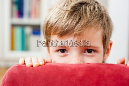 young boy hiding