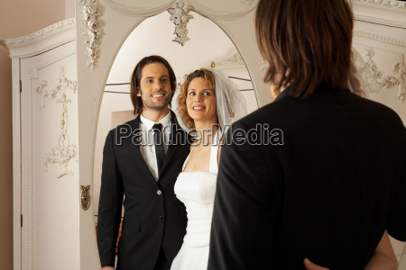 young bridal couple smiling