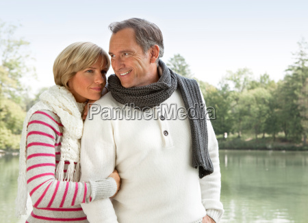 middle aged couple at a lake