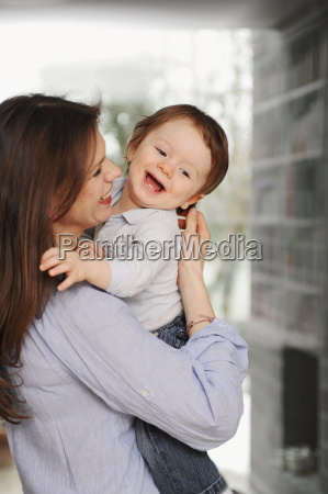 mother holding toddler son
