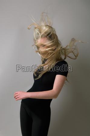 teenage girls hair blowing in wind