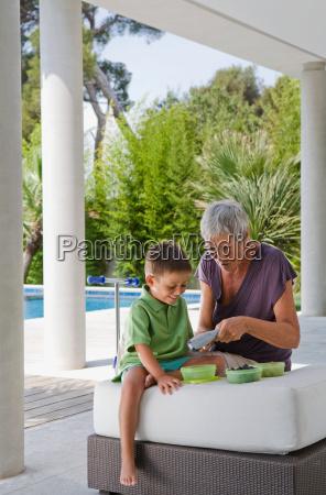 woman and boy peeling fruit