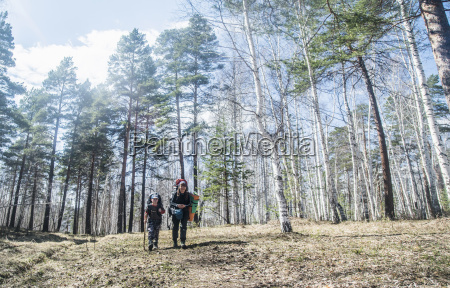 young adult man and boy hiking