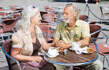 couple holding hands by table