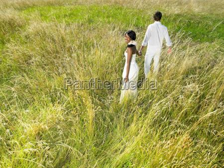married, couple, walking, in, a, field - 18224860