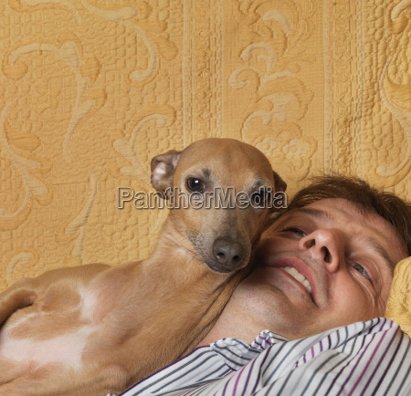 dog and man cuddling