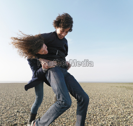 couple playing on beach