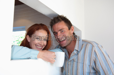 smiling couple having coffee together
