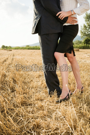 couple in a wheat field