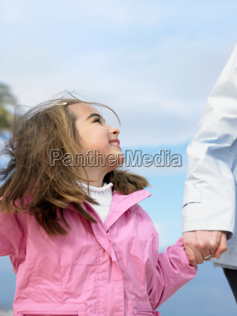 young girl looking up at mother