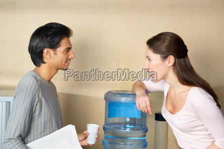 man and woman chatting by water