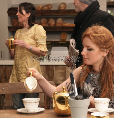 young woman having tea in cafe