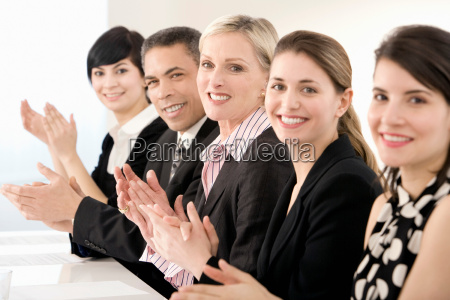 a line of business people clapping