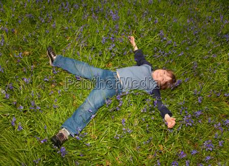 boy 6 8 lying in field