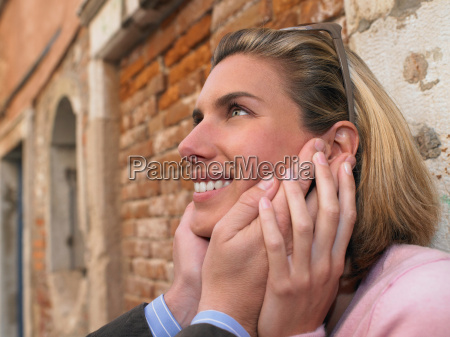 man holding womans face