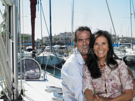 mature couple relaxing on yacht