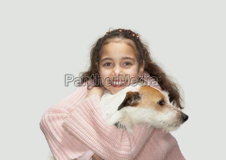 girl holding terrier