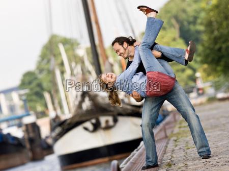man and woman playing around