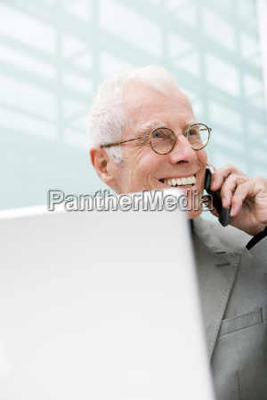 older man using cell phone
